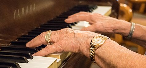 Elderly woman plays piano