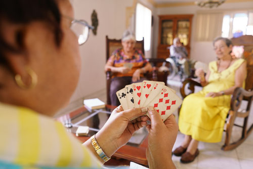 Elderly women play cards